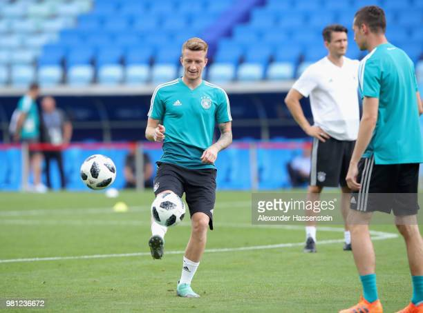 Marco Reus of Germany plays the ball with his team mate Julian Draxler during the Germany Training Press Conference at Fisht Stadium on June 22 2018...
