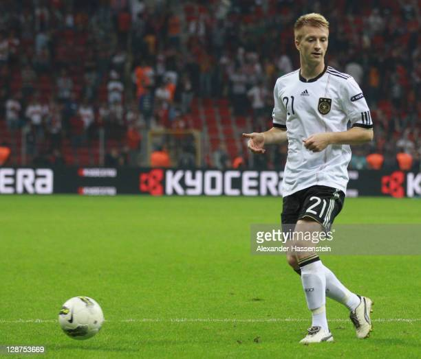 Marco Reus of Germany runs the ball with during the UEFA EURO 2012 Group A qualifying match between Turkey and Germany at Tuerk Telekom Arena on...
