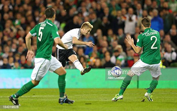 Marco Reus of Germany scores his second goal during the FIFA 2014 World Cup Qualifier Group C match between Republic of Ireland and Germany at the...