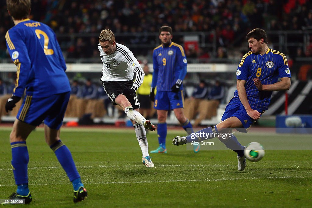 Marco Reus of Germany scores his team's first goal against Viktor Dmitrenko of Kazakhstan during the FIFA 2014 World Cup qualifier between Germany and Kazakhstan at Grundig-Stadion on March 26, 2013 in Nuremberg, Germany.