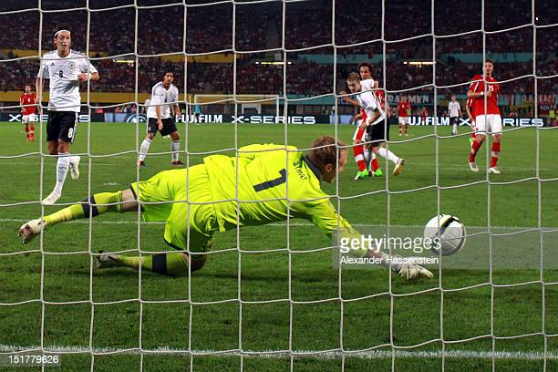 Marco Reus of Germany scores the first goal against keeper Robert Almer of Austria during the FIFA 2014 World Cup Qualifier group C match between...