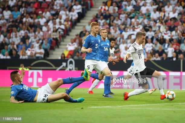 Marco Reus of Germany scores the opening goal during the UEFA Euro 2020 Qualifier match between Germany and Estonia at Opel Arena on June 11, 2019 in...