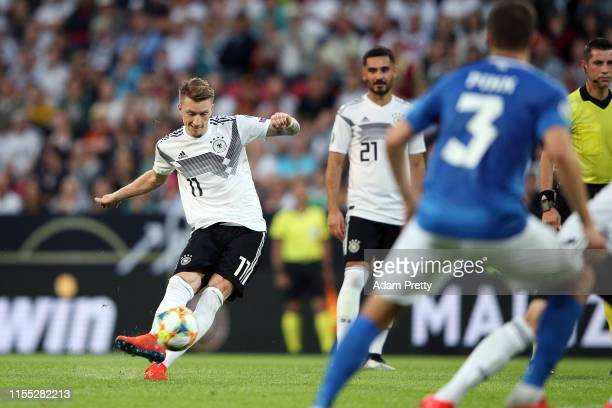 Marco Reus of Germany socres the fifth goal during the UEFA Euro 2020 Qualifier match between Germany and Estonia at Opel Arena on June 11, 2019 in...