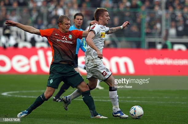Marco Reus of Gladbach and Andreas Wolf of Bremen battle for the ball during the Bundesliga match between Borussia Moenchengladbach and SV Werder...