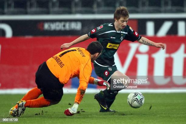 Marco Reus of Gladbach dribbles around Raphael Schaefer of Nuernberg during the Bundesliga match between Borussia Moenchengladbach and 1. FC...