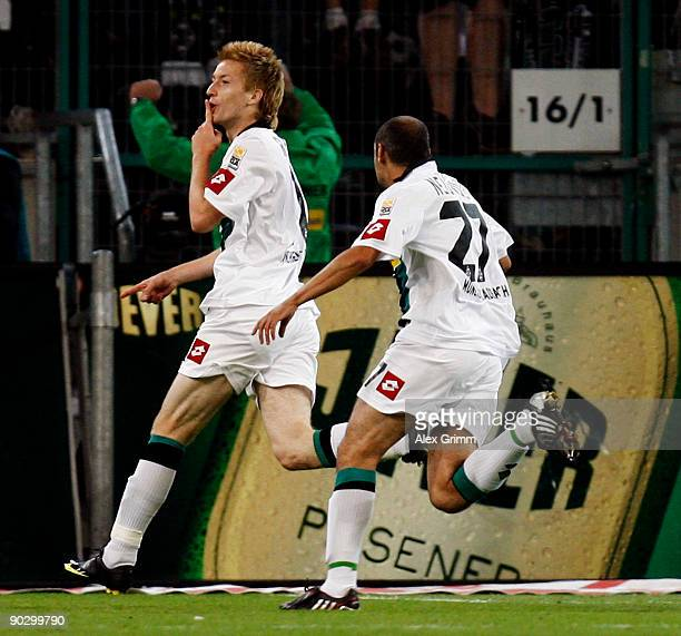 Marco Reus of M'gladbach celebrates his team's second goal with team mate Oliver Neuville during the Bundesliga match between Borussia M'gladbach and...