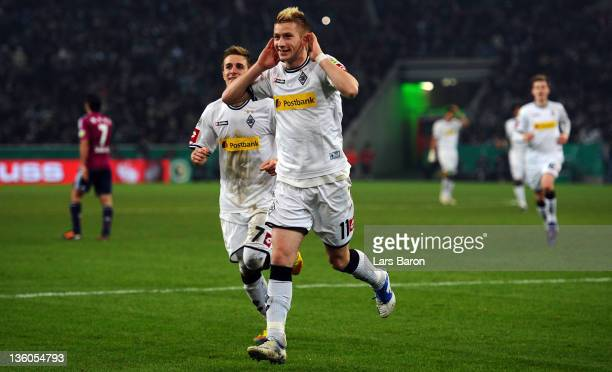 Marco Reus of Moenchengladbach celebrates after scoring his teams second goal during the DFB Cup round of sixteen match between Borussia...