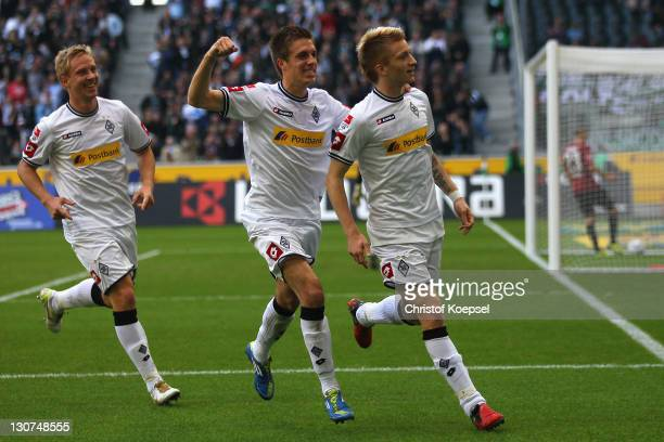 Marco Reus of Moenchengladbach celebrates the first goal with Patrick Herrmann and Mike Hanke of Moenchengladbach during the Bundesliga match between...