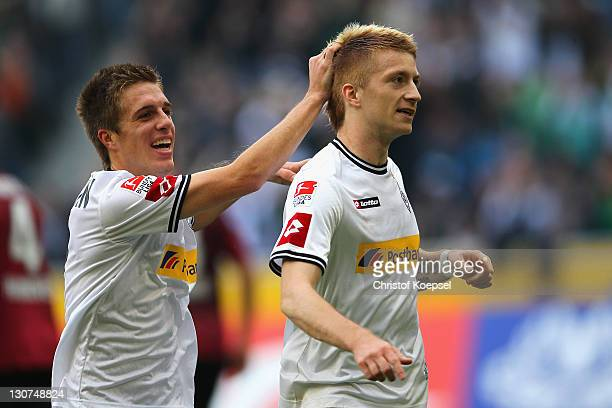 Marco Reus of Moenchengladbach celebrates the first goal with Patrick Herrmann during the Bundesliga match between Borussia Moenchengladbach and...