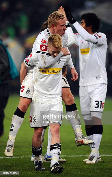 Marco Reus of Moenchengladbach celebrates with team mate Mike Hanke after winning the Bundesliga match between Borussia Moenchengladbach and FC...