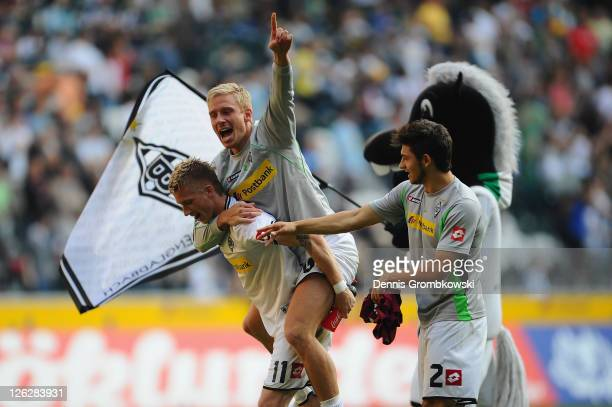 Marco Reus of Moenchengladbach celebrates with team mates Mike Hanke and Matthias Zimmermann after the Bundesliga match between Borussia...