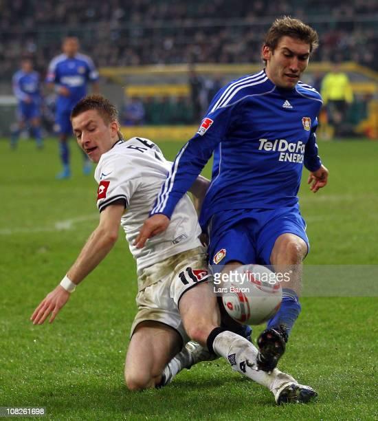 Marco Reus of Moenchengladbach challenges Stefan Reinartz of Leverkusen during the Bundesliga match between Borussia Moenchengladbach and Bayer...