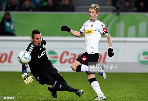 Marco Reus of Moenchengladbach fails to score over Diego Benaglio goalkeeper of Wolfsburg during the Bundesliga match between VfL Wolfsburg and...