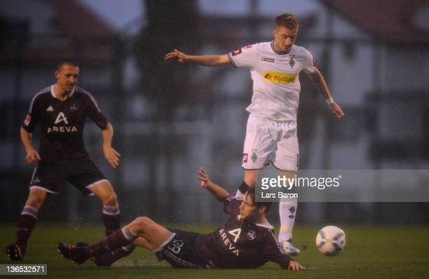 Marco Reus of Moenchengladbach is challenged by Philipp Wollscheid of Nuernberg during a friendly match between Borussia Moenchengladbach and 1 FC...