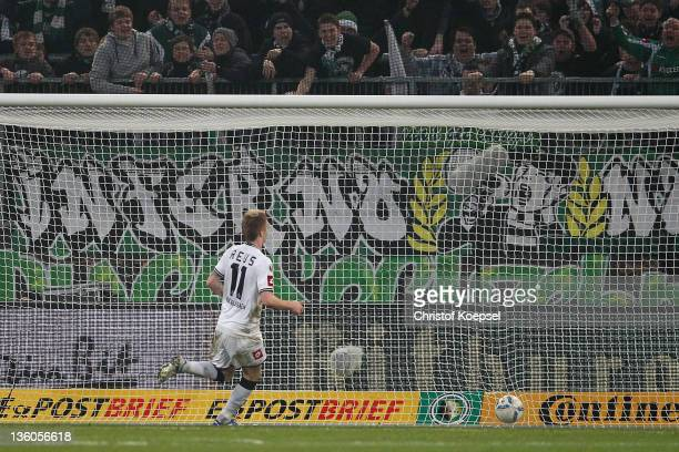 Marco Reus of Moenchengladbach scores the third goal during the DFB Cup round of sixteen match between Borussia Moenchengladbach and FC Schalke 04 at...