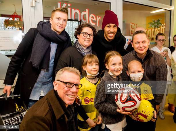 Marco Reus PierreEmerick Aubameyang and Manager Peter Stoeger of Borussia Dortmund are seen during the annual visit of Borussia Dortmund at the...