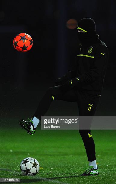 Marco Reus plays with a ball during a Borussia Dortmund training session ahead of their UEFA Champions League group stage match against Manchester...