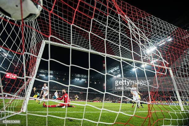 Marco Reus scores his teams first goal during the Bundesliga match between 1 FC Koeln and Borussia Dortmund at RheinEnergieStadion on December 10...