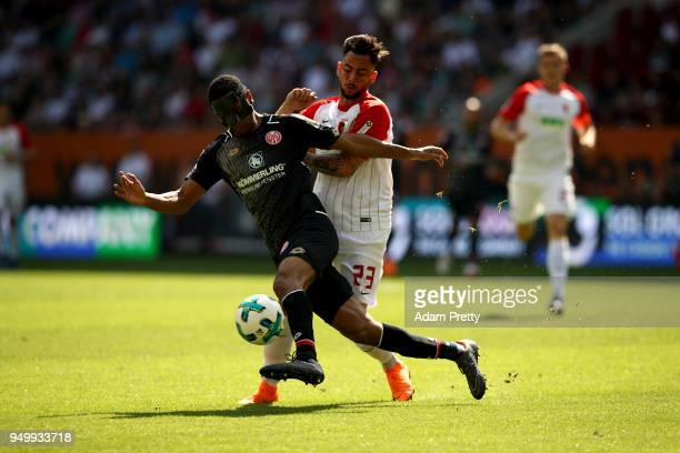 Marco Richter of Augsburg and Abdou Lakhad Diallo of Mainz battle for the ball during the Bundesliga match between FC Augsburg and 1 FSV Mainz 05 at...