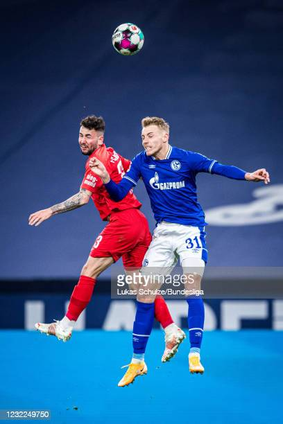Marco Richter of Augsburg and Timo Becker of Schalke in action during the Bundesliga match between FC Schalke 04 and FC Augsburg at Veltins-Arena on...