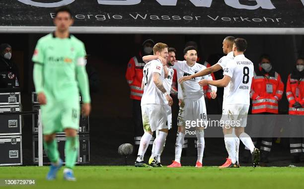 Marco Richter of Augsburg celebrates after scoring their sides second goal during the Bundesliga match between FC Augsburg and Borussia...