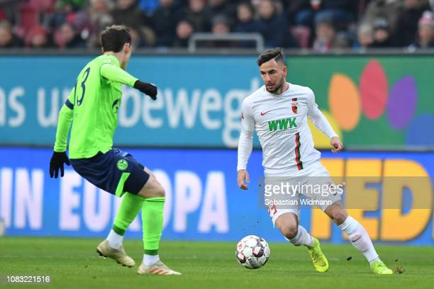 Marco Richter of Augsburg plays the ball during the Bundesliga match between FC Augsburg and FC Schalke 04 at WWKArena on December 15 2018 in...
