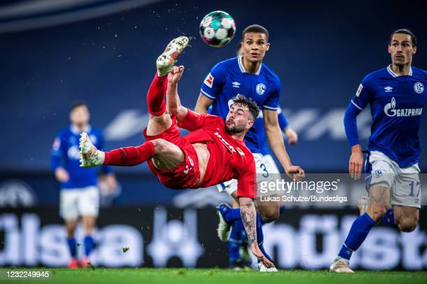 Marco Richter of Augsburg with a bicycle kick during the Bundesliga match between FC Schalke 04 and FC Augsburg at Veltins-Arena on April 11, 2021 in...
