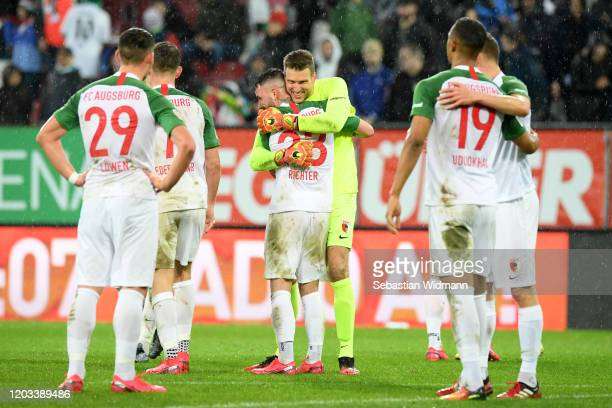 Marco Richter of FC Augsburg and goalkeeper Andreas Luthe of FC Augsburg celebrate after the Bundesliga match between FC Augsburg and SV Werder...