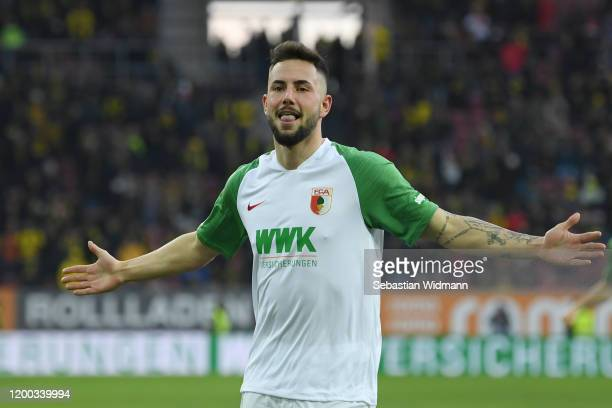 Marco Richter of FC Augsburg celebrates after scoring his team's second goal during the Bundesliga match between FC Augsburg and Borussia Dortmund at...