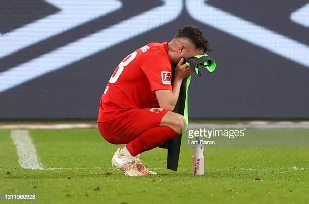 Marco Richter of FC Augsburg looks dejected after the Bundesliga match between FC Schalke 04 and FC Augsburg at Veltins-Arena on April 11, 2021 in...