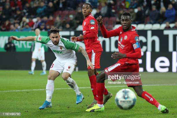 Marco Richter of FC Augsburg shoots during the Bundesliga match between FC Augsburg and 1. FSV Mainz 05 at WWK-Arena on December 07, 2019 in...