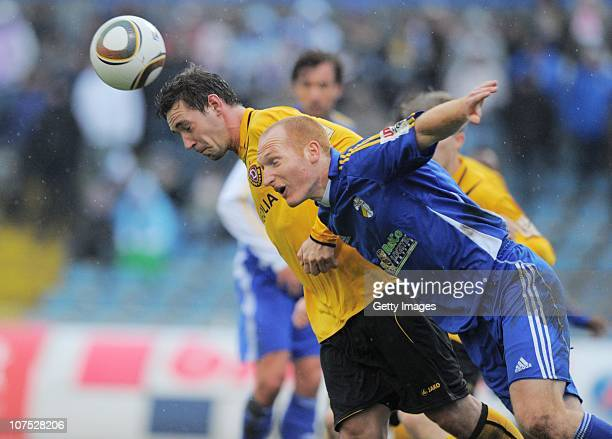 Marco Riemer of Carl Zeiss Jena and Maik Kegel of Dynamo Dresden battle for the ball during the Third League match between Carl Zeiss Jena and Dynamo...