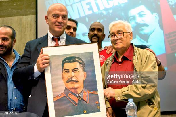 Marco Rizzo general secretary of the Communist Party displays a portrait of Joseph Stalin during the event International Long Live The Soviet...