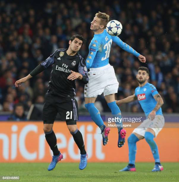 Marco Rog of Napoli competes for the ball with Alvaro Morata of Real Madrid during the UEFA Champions League Round of 16 second leg match between SSC...