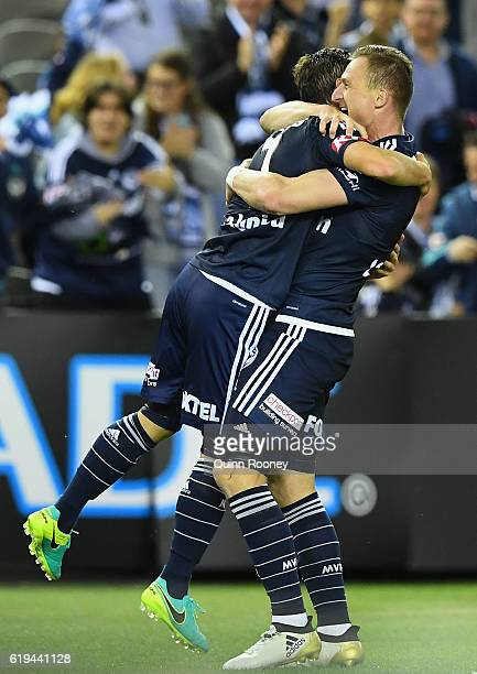 Marco Rojas and Besart Berisha of the Victory celebrate a goal during the round four ALeague match between the Melbourne Victory and Wellington...