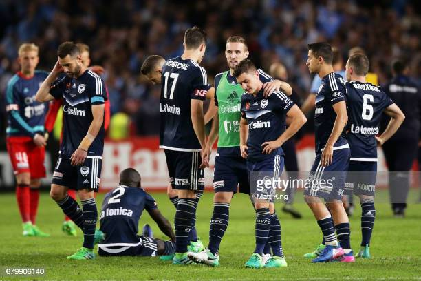 Marco Rojas of Melbourne Victory and team mates look dejected after losing the penalty shoot out during the 2017 ALeague Grand Final match between...