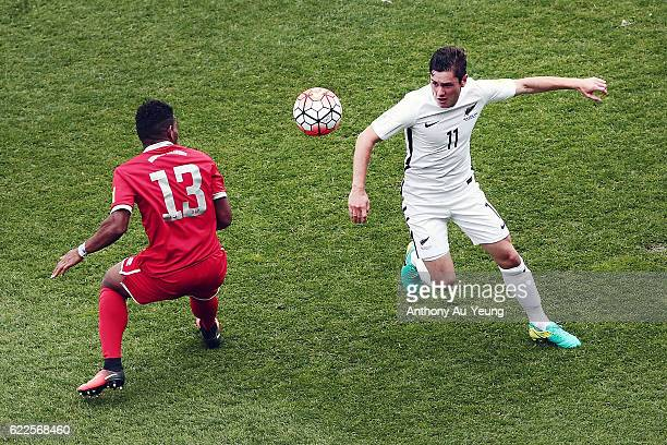 Marco Rojas of New Zealand competes against Roy Kayara of New Caledonia during the 2018 FIFA World Cup Qualifier match between the New Zealand All...