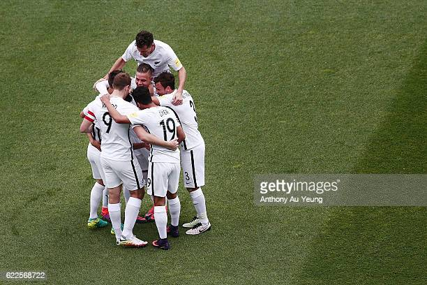 Marco Rojas of New Zealand is mobbed by teammates after scoring the second goal during the 2018 FIFA World Cup Qualifier match between the New...