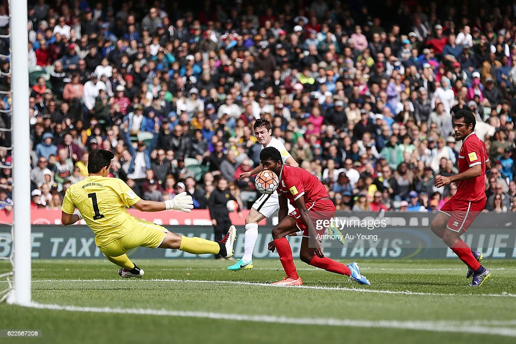 Marco Rojas of New Zealand shoots and scores the opening goal during the 2018 FIFA World Cup Qualifier match between the New Zealand All Whites and New Caledonia at QBE Stadium on November 12, 2016 in Auckland, New Zealand.