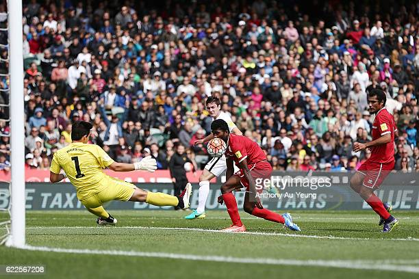 Marco Rojas of New Zealand shoots and scores the opening goal during the 2018 FIFA World Cup Qualifier match between the New Zealand All Whites and...