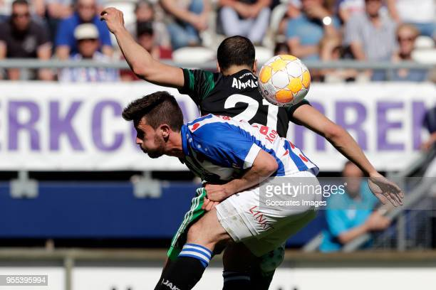 Marco Rojas of SC Heerenveen Sofyan Amrabat of Feyenoord during the Dutch Eredivisie match between SC Heerenveen v Feyenoord at the Abe Lenstra...