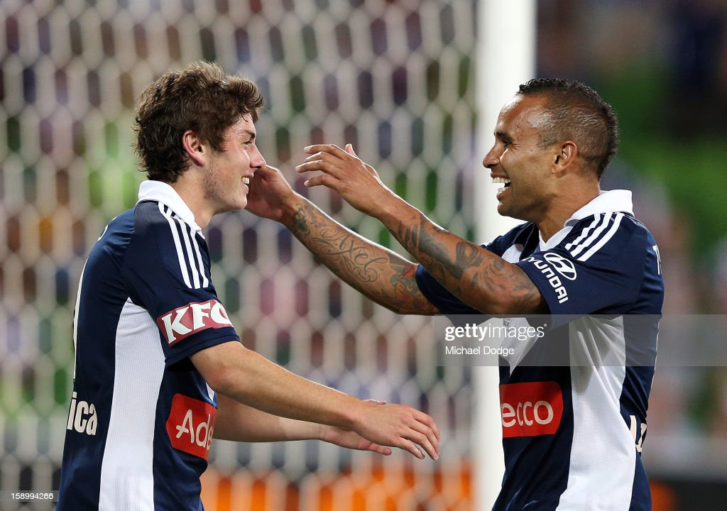 Marco Rojas (L) of the Melbourne Victory celebrates his goal with Archie Thompson during the round 15 A-League match between the Melbourne Victory and Wellington Phoenix at AAMI Park on January 5, 2013 in Melbourne, Australia.