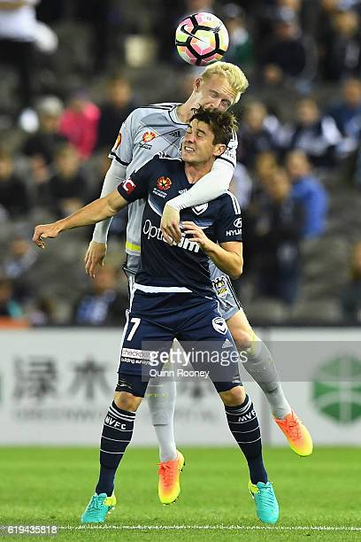 Marco Rojas of the Victory and Adam Parkhouse of the Phoenix compete to head the ball during the round four ALeague match between the Melbourne...