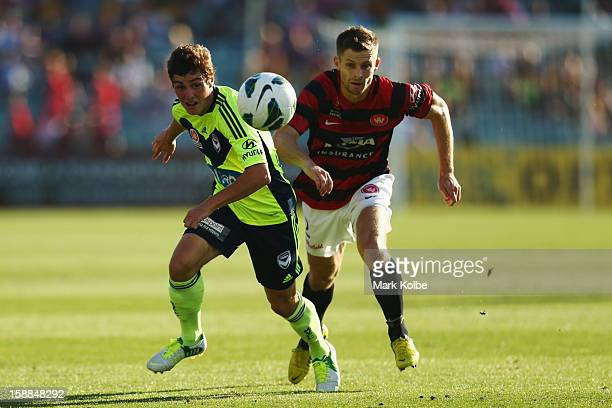 Marco Rojas of the Victory and Shannon Cole of the Wanderers compete for the ball during the round 14 ALeague match between the Western Sydney...