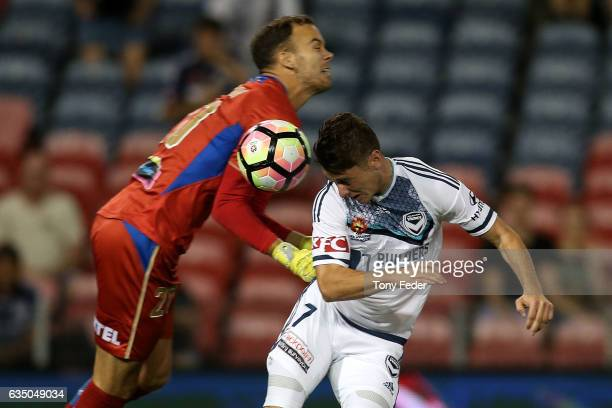 Marco Rojas of the Victory attempts to head the ball past Jack Duncan of the Jets during the round 19 ALeague match between the Newcastle Jets and...