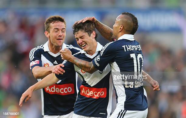 Marco Rojas of the Victory celebrates after he scored the first goal with Archie Thompson and Matthew Foschini during the round 13 ALeague match...