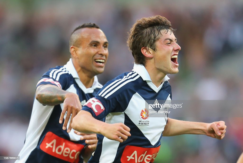 Marco Rojas (R) of the Victory celebrates after he scored the first goal with Archie Thompson during the round 13 A-League match between the Melbourne Victory and the Newcastle Jets at AAMI Park on December 28, 2012 in Melbourne, Australia.