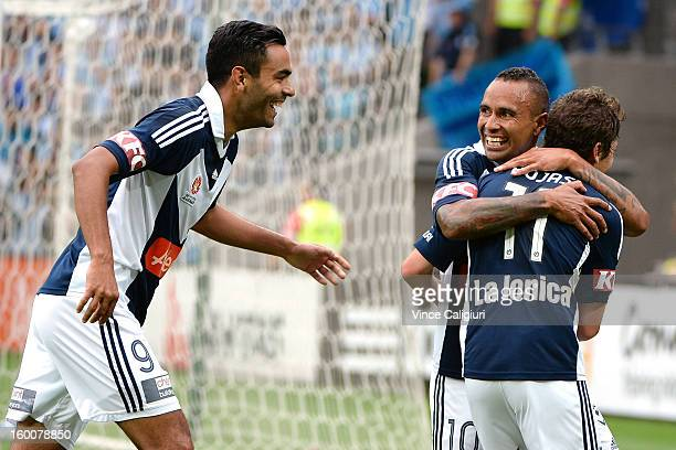 Marco Rojas of the Victory celebrates his goal with teammates Marcos Flores and Archie Thompson in the first half of the round 18 ALeague match...