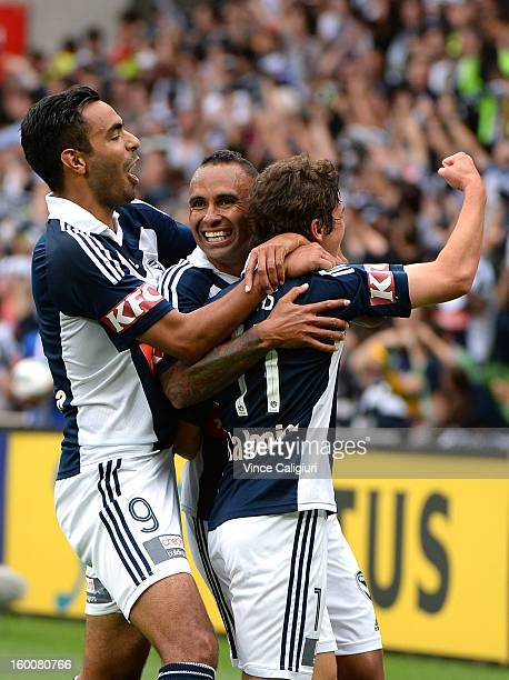 Marco Rojas of the Victory celebrates his goal with teammates Marcos Flores and Archie Thompson in the first half during the round 18 ALeague match...