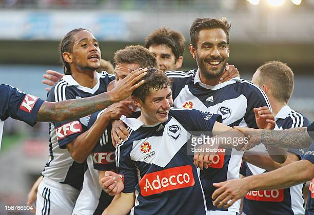 Marco Rojas of the Victory celebrates with his team mates after he scored the first goal during the round 13 ALeague match between the Melbourne...